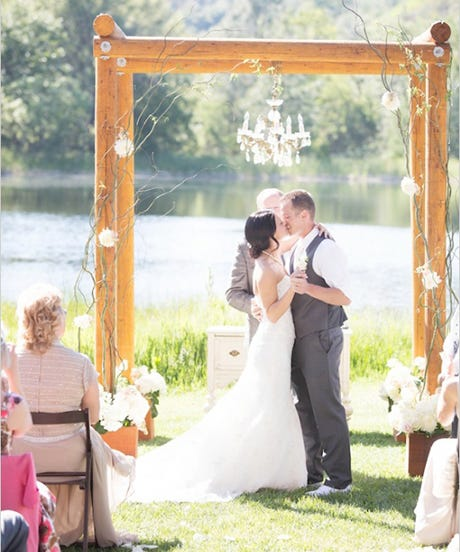 Forget The Traditional Arch These Days Anything Can Become A Beautiful Backdrop At Real Wedding Ceremony Old Barn Doors Colorful Streamers