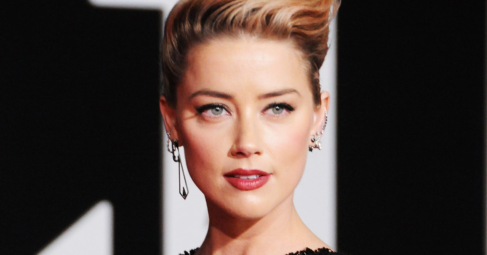 "Amber Heard Says She Never Came Out Because She Was ""Never In"""