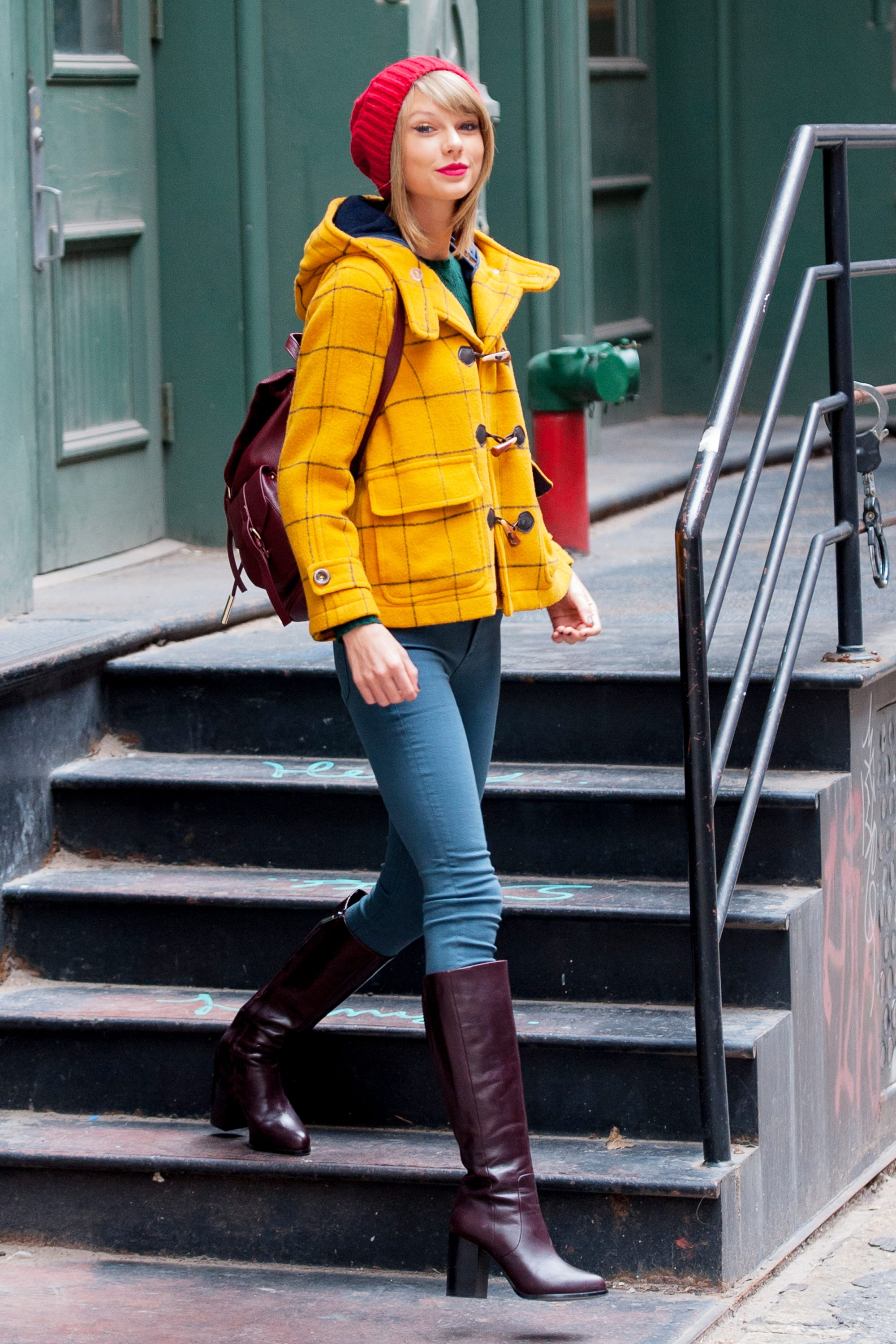 taylor swift bright yellow winter coat outfit