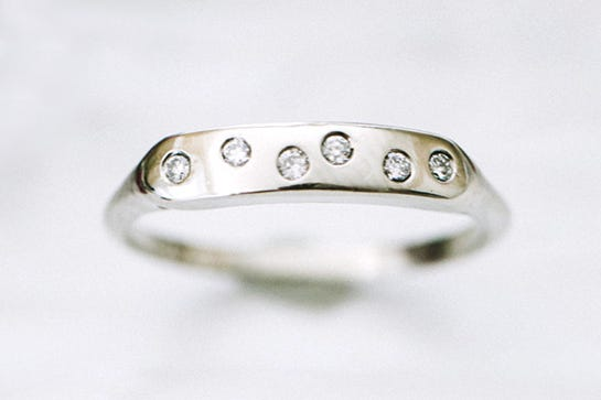 six quirky diamonds that need to live on your ring finger porter gulch diamond sprinkled band available at etsy - Coolest Wedding Rings