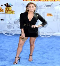We know: Life's unfair. Why we're not all Jennifer Lopez is something that we're going to just have to accept. This belted blazer-style Versus Versace dress is one of the best things we've ever seen JLo wear. Between that high hemline, all that bold gold jewelry, and those pencil-thin Giuseppe Zanotti sandals, Lopez is the HBIC of this red carpet.Anthony Vaccarello x Versus Versace Long Blazer, $841.49, available at Farfetch.