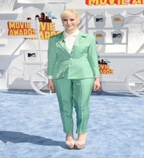 Designer Rachel Antonoff's personal brand of clothing has always been equal parts sweet and salty, and this seafoam green suit brings a little theatricality to the red carpet in a way that a dress never could. With a ruffled shirt underneath, this suit might have been mistaken as a castoff from the archives of The Wedding Singer, but the Old Hollywood makeup and platform sandals keep it decidedly ladylike.For A Similar Style Try:Smythe Rumpled Crepe Military Blazer, $595, available at Neiman Marcus.
