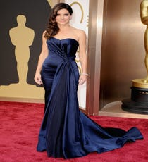 Sandra Bullock — While Bullock isn't known as a sartorial trailblazer (the day we see her in a neon pantsuit on the red carpet will be a strange one indeed), she might have one of the best track records out there in terms of always looking gorgeous. In a navy, strapless Alex