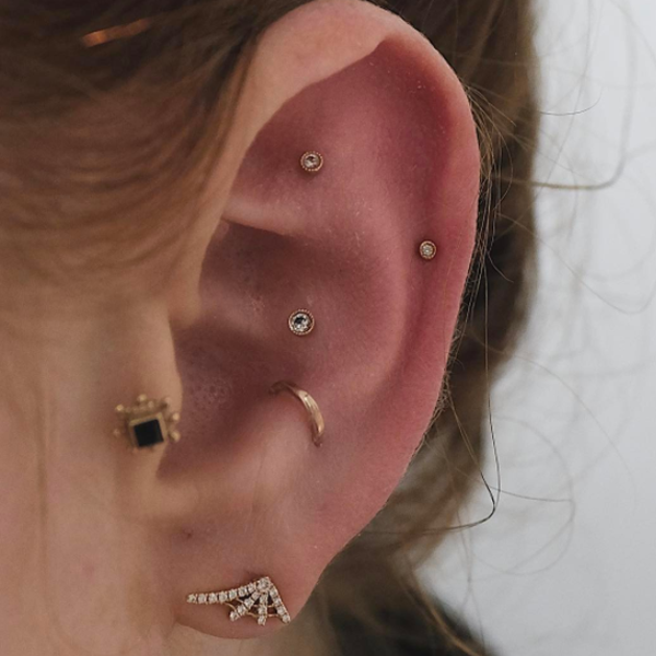 NYC Piercing Trends - Cool Earring Combinations Photos Ear Piercings Anti Tragus