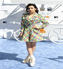 A pastel-gingham trench dress and witchy white lace-up boots? Not exactly red carpet fodder, which is why we're so obsessed with it. Charli XCX has never really paid much attention to how peers fared on awards shows' do's-and-don'ts lists, which has given her the freedom to take risks. The beauty of this outfit is not only in how strangely sweet it is, but also in the fact that it's easily replicable with one trip to the thrift shop...For A Similar Style Try:Equipment Brett Paramount Plaid Silk Shirtdress, $298, available at Nordstrom.