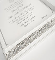 The Invitations  Stationer to the stars Lehr & Black brings the purpose of invitations to a whole new level. Specializing in intricate bejeweled boxes and metallic inks, the L.A.-based company is the go-to wedding source for Hollywood couples, like Fergie and Josh Duhamel and Salma Hayek and François-Henri Pinault. Swarovski crystal-encrusted invitations nestled in a crocodile-skin box cost $500 a pop.     Photo: Courtesy of Lehr & Black