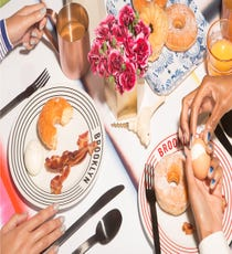 Brunch Of Champions For a modern-looking brunch table, pile your food on striped plates with an ombré tablecloth and copper glasses. Our brunch of choice involves bacon, eggs, and doughnuts — basically, all the best things.