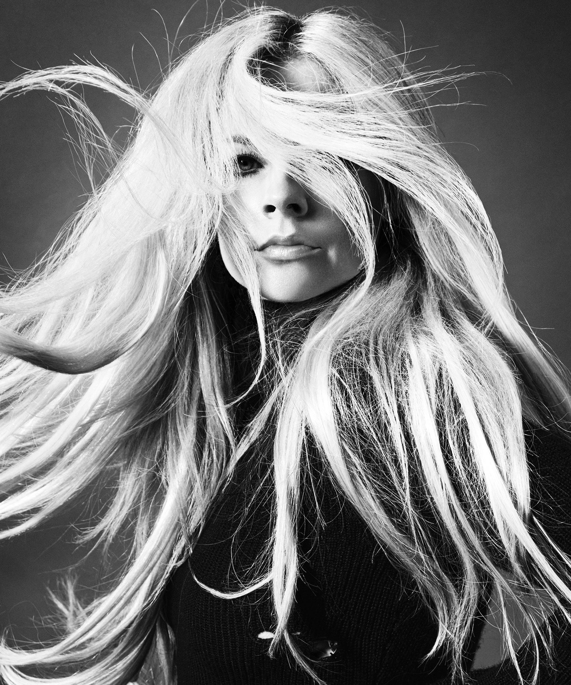 Avril Lavigne Struggles To Keep Her Head Above Water On Latest Album