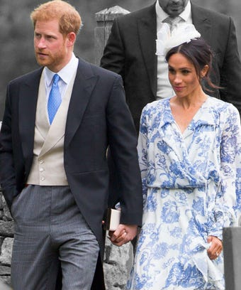 Prince Harry and Meghan Markle attending wedding.