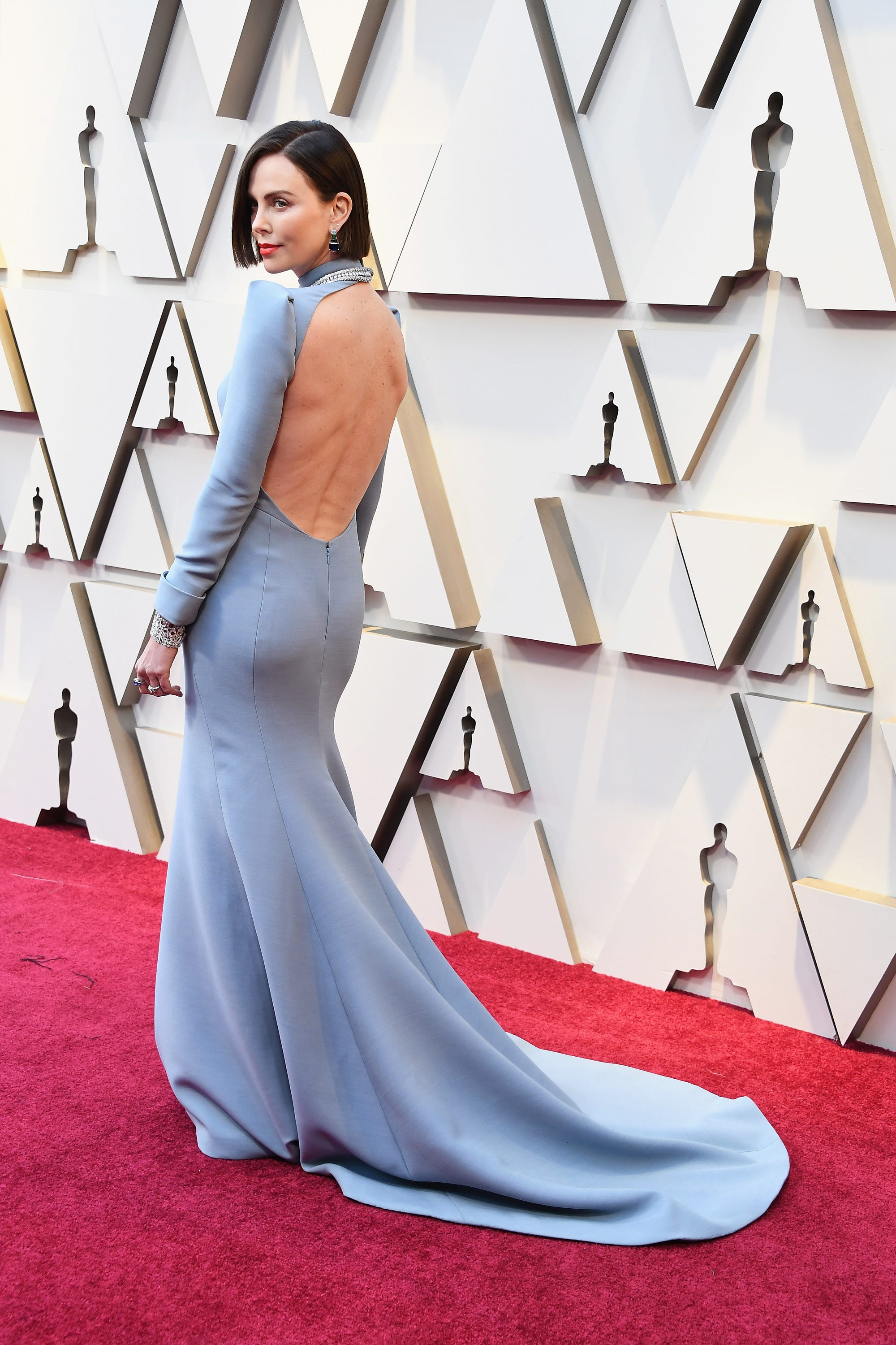 69b026284e Charlize Theron Open Back Oscars Dress Is A Daring Look