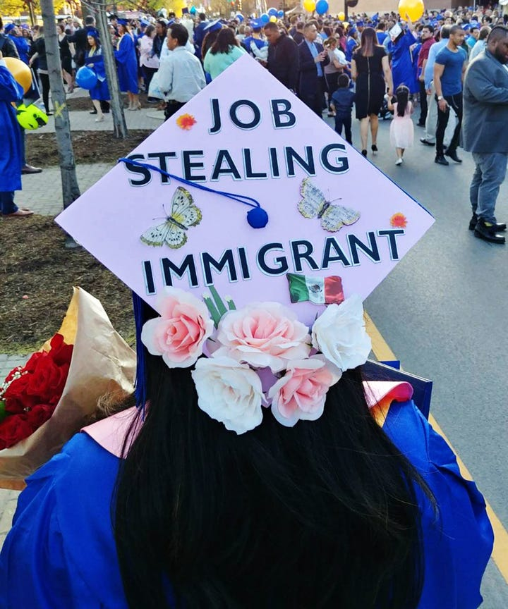 undocumented women use graduation caps for message